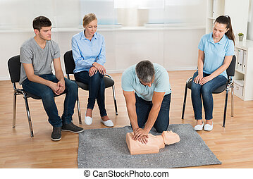 Instructor Teaching First Aid Cpr Technique
