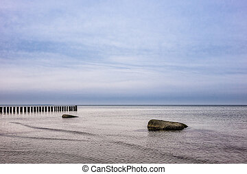 Groynes on shore of the Baltic Sea on the island Poel...