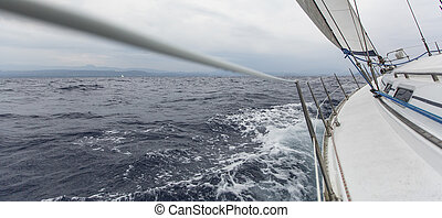 Yachting sport Sailing in the wind through the waves Sailing...