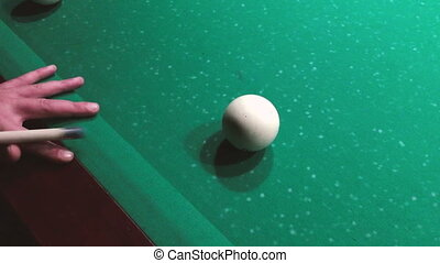 Man supports cue by hand and aiming. - Man supports cue by...