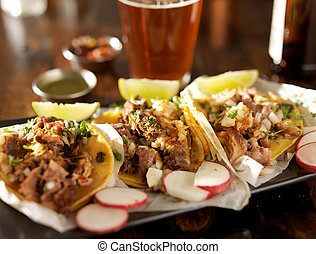 beer and mexican street tacos with radish