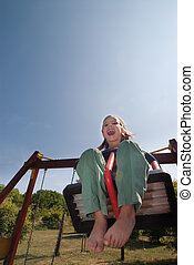 Cheerful little girl high up on the swing - Cheerful little...