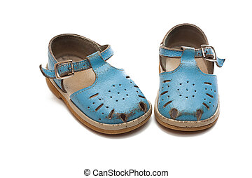 Pair of shoes - Worn-out children`s pair of shoes. The first...