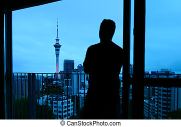 Man looking out window  on Auckland  New Zealand