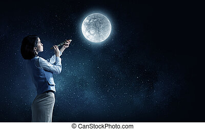Is there life on moon - Young businesswoman looking in...