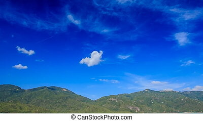 seagull lives in cloud-land over hilly island tranquil azure...