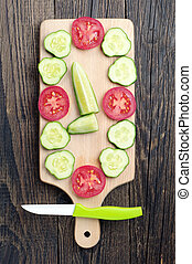 Slices cucumber and tomato and knife - Slices cucumber and...
