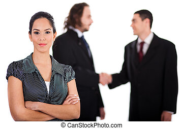 Smiling business women in focus with two business collegue welcoming each other