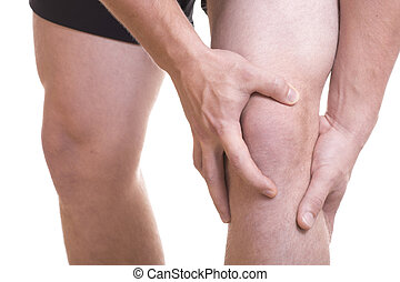 Knee Pain and Injury - Closeup young Caucasion male athlete...