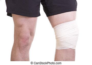 Knee injury with sports bandage - Closeup Caucasian male...