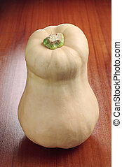 Butternut squash on wooden table