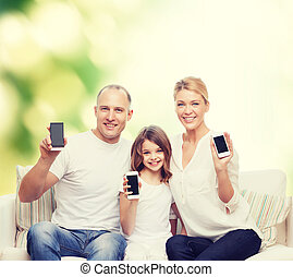 happy family with smartphones - summer, technology,...