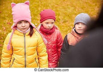 sad kids being blamed for misbehavior outdoors - childhood,...