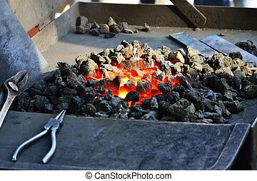 Small fire for forging metal