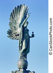 War memorial statue and wings
