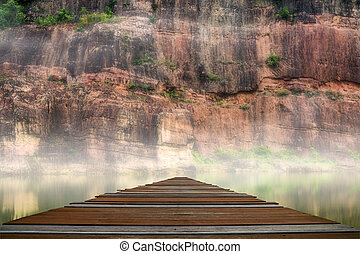 Wooden walkway into the mountain.