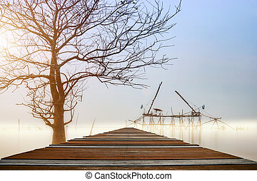 Wooden walkway over the lake in the morning