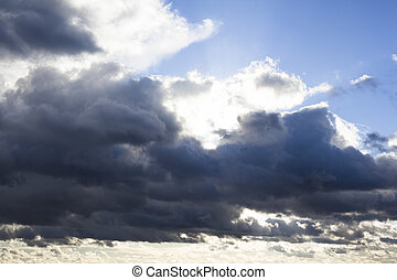 Cloudscape with the sun behind the clouds - Cloudscape with...