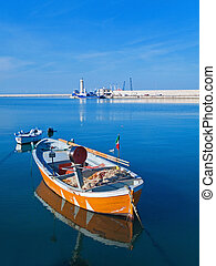 Landscape view of Molfetta touristic port with rowboats -...