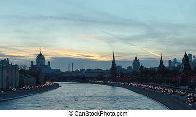 Ensemble of Moscow Kremlin and Moskva-City business center view across Moskva river at a winter day to night timelapse hyperlapse