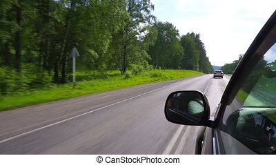 Driving on road in car