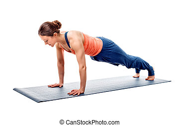Young fit sporty woman does Hatha yoga plank asana - Young...