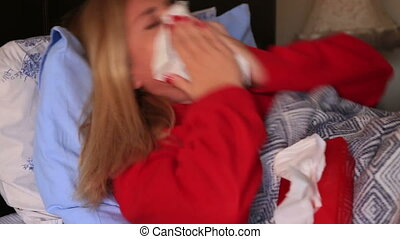 Sick woman caught a cold - Frustrated sick woman lying on a...