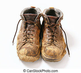 Muddy boots  - Pair of dirty brown walking boots