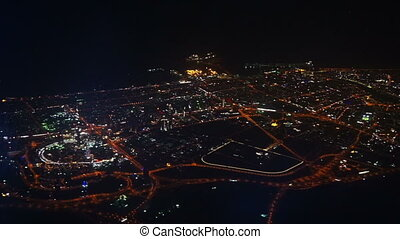 Aerial view on Dubai from flying airplane at night - Aerial...