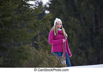 portrait of beautiful young redhair woman in snow scenery...