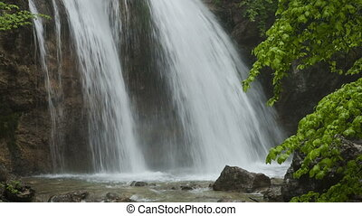 Beautiful waterfall Jur-Jur among green forest