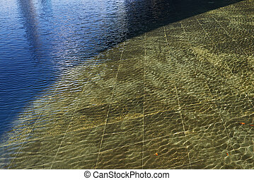 wave pattern with light and shadow on water surface