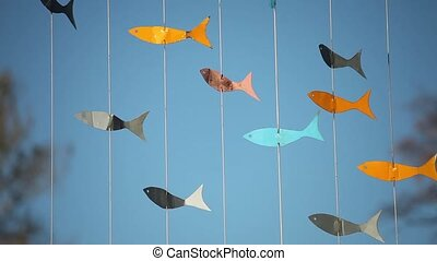 vane fish on a blue background - vane flock of colorful fish...