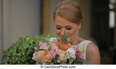 Smiling bride holding big wedding bouquet - Smiling bride...