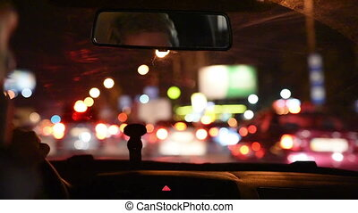 Driving night city heavy traffic View from inside the car