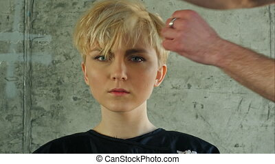 Young woman getting new hairdress.