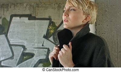 Young blond girl with modern haircut posing. Professional...