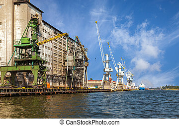 Grain elevator - Old grain elevator whit cranes in port of...