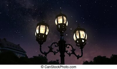 Town at night - Vintage street lamp against the starry night...