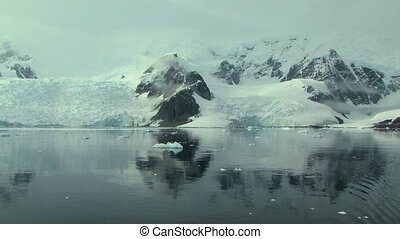 antarctic peninsula reflected in the ocean
