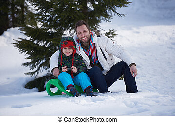 portrait of father and son on snow