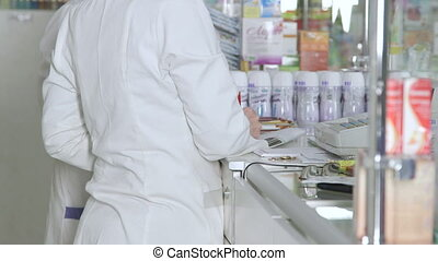 pharmacists working at pharmacy - Female pharmacists working...