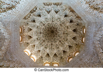 Ornate ceiling carvings in Alhambra palace Granada