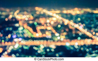 Abstract city bokeh light background - vintage tone blur...