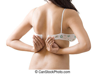 Dressing or Undressing designer bra - Womans back, hand and...