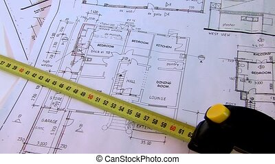 buildings plans and tape measure