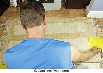 Man Placing Anti Slip Rug Grips