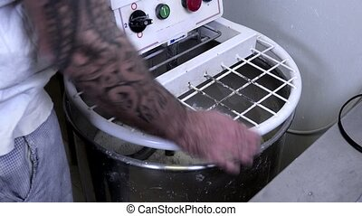 preparation of the bread dough - starting up the machine to...