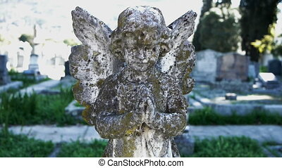 angel sculpture in a graveyard