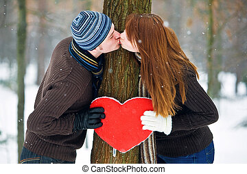 Couple with heart - Couple with red heart kissing